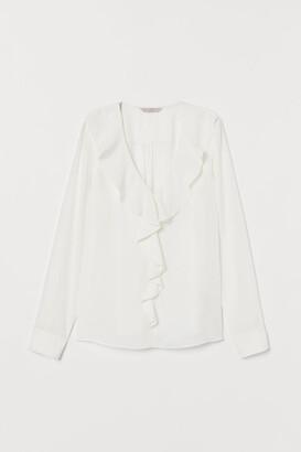 H&M Flounced V-neck blouse