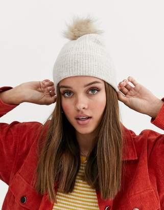 Asos Design DESIGN fluffy beanie hat with faux fur pom-Beige