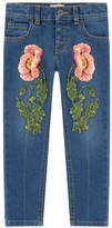 Gucci Embroidered girl slim fit jeans