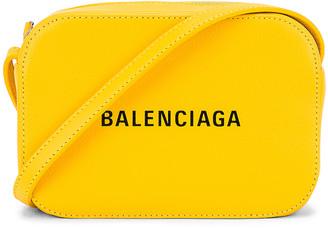 Balenciaga XS Logo Everyday Camera Bag in Yellow & Black | FWRD
