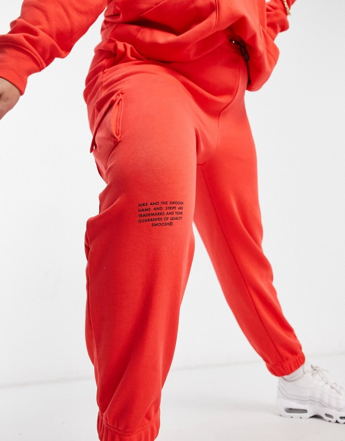 Thumbnail for your product : Nike Swoosh Plus fleece trackies in red