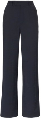Situationist High-waisted checked trousers