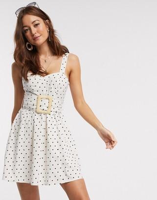 ASOS DESIGN mini skater sundress with wicker belt in polka dot