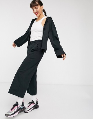Nike premium tonal cropped wide leg sweatpants in black