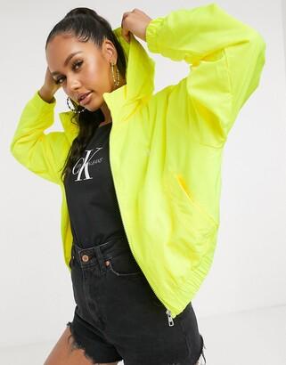 Calvin Klein Jeans logo windreaker in yellow
