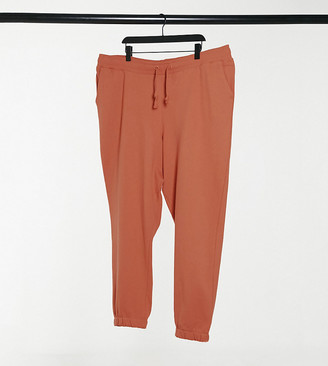 Collusion Plus exclusive colour skinny trackies in blush