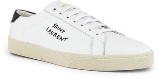 Saint Laurent SL06 Signa Low Top Sneaker in Optic White | FWRD