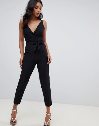ASOS DESIGN wrap front jumpsuit with peg leg and self belt in black