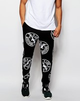 Love Moschino Joggers In All Over Logo Print - Black