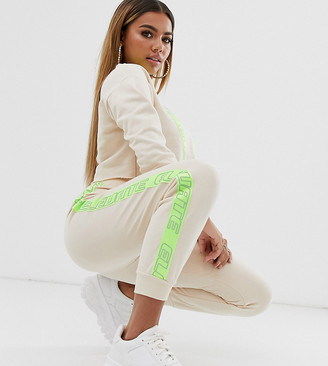 Asos DESIGN Petite tracksuit cropped sweat / jogger with neon reflective tape-Beige