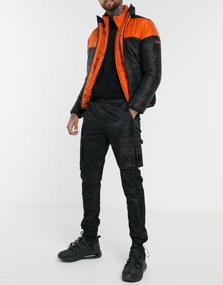 N. Liquor Poker colour block cargo trousers in black and orange