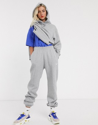 Nike mini Swoosh oversized grey joggers