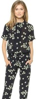 gwen stefani  Who made  Gwen Stefanis black floral short sleeve jumpsuit and sandals?