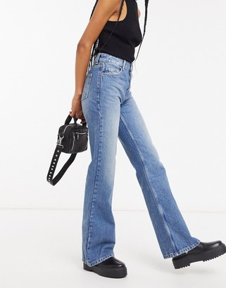 Topshop ONE oversized Mom jeans in mid wash