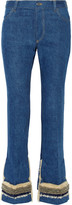 Toga Faux shearling-trimmed embellished high-rise flared jeans