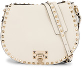 Valentino Small Rockstud Saddle Bag in Light Ivory | FWRD