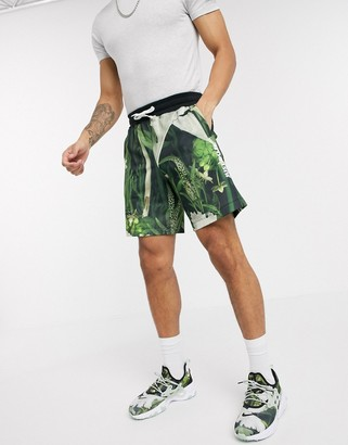 Nike Just Do It shorts in tropical leaf print