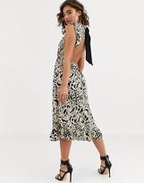 Pretty Lavish backless midi dress in animal print with ruffle detail