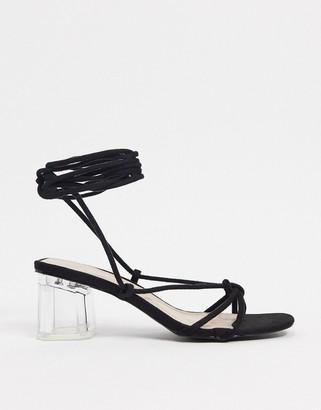 BEBO tie leg mid heeled clear sandals in black