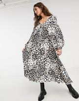 Asos Design DESIGN textured midi V neck swing dress in animal print