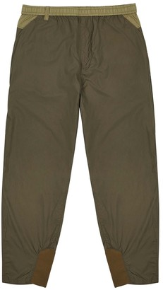 White Mountaineering Army green tapered trousers