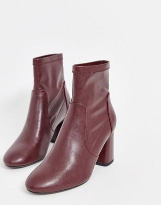 Bershka faux leather heeled boot in burgundy