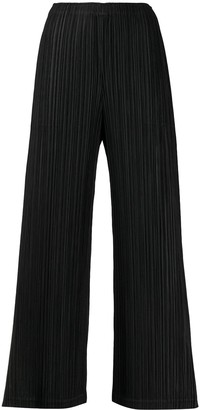 Pleats Please Issey Miyake wide leg pleated trousers