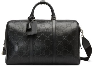 Gucci GG Embossed Leather Duffle Bag