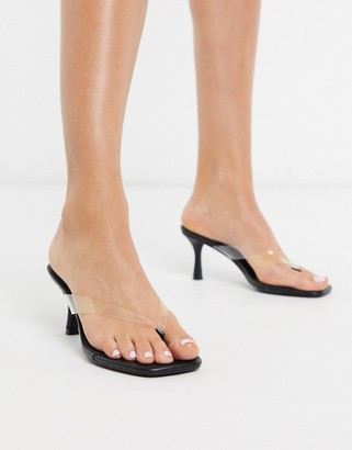Truffle Collection flip flop mid-heels in clear and black