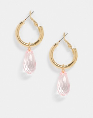 ASOS DESIGN hoop earrings with faceted pink bead drop in gold tone