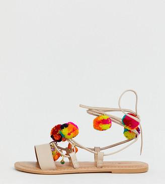 Asos DESIGN Wide Fit Fun Fair pom pom leather tie leg flat sandals