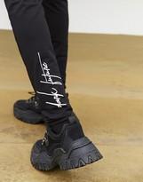 Asos Design DESIGN x Dark Future co-ord super skinny joggers in black with logo print