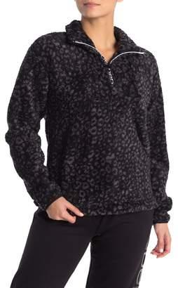 Bebe Logo Quarter Zip Leopard Print Faux Fur Pullover
