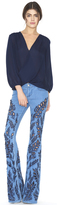 Alice + Olivia Light Indigo Ryley Low Rise Embroidered Bell Jeans