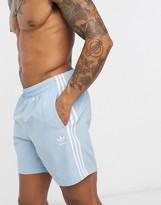 adidas 3 stripe swim shorts in light blue