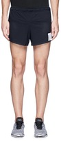 "Satisfy 'Long Distance 2.5""' perforated running shorts"