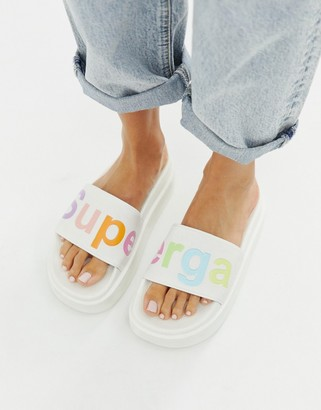 Superga white slides with multi logo flatform