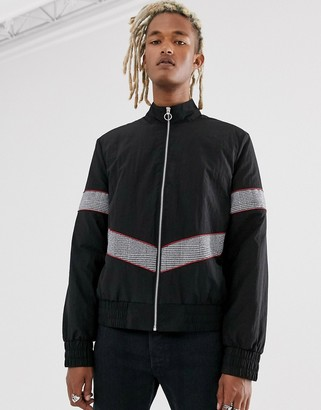 Asos Design DESIGN windbreaker in black with contrast check panelling
