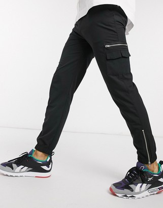ASOS DESIGN slim sweatpants with MA1 pocket & zip pockets