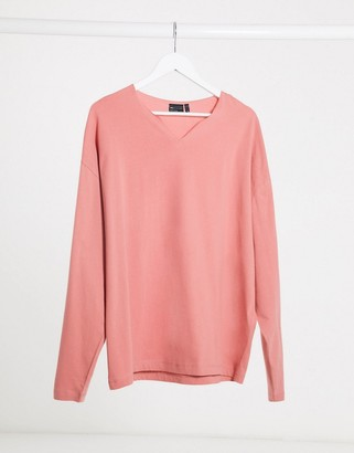 ASOS DESIGN oversized long sleeve t-shirt with notch neck in pink