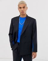 Asos DESIGN boxy double breasted suit jacket in navy with insert side stripe
