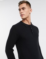 Jack and Jones textured long sleeve knitted polo in black with recycled polyester fibres