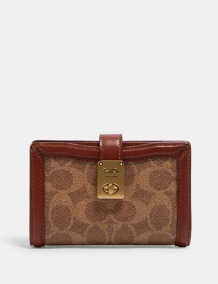 Coach Hutton Wallet In Signature Canvas