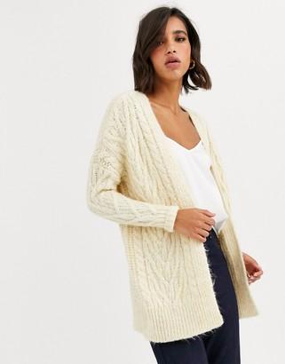 Vero Moda oversized knitted cardigan in cream-Beige
