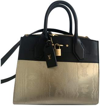 Louis Vuitton City Steamer Gold Leather Handbags
