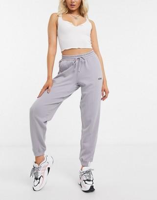 adidas RYV cuffed joggers in lilac