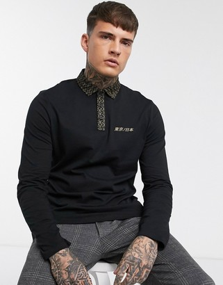 Asos DESIGN organic cotton long sleeve polo with woven printed collar and chest print
