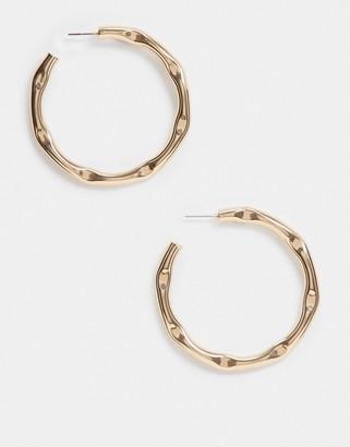 ASOS DESIGN hoop earrings in pinched molten design in gold tone