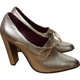 Louis Vuitton Golden Lace up heels