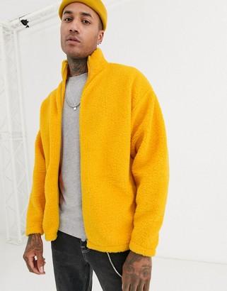 ASOS DESIGN oversized track top in yellow teddy borg